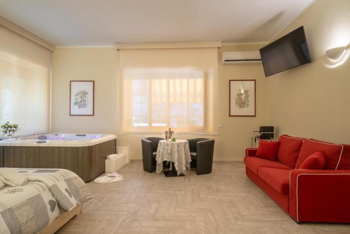 Suite con Vasca idromassaggio divano-letto e soggiorno