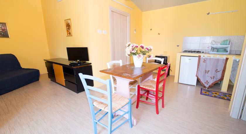 Appartamenti in Villaggio con Piscina e Ristorante