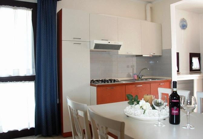 Soggiorno con angolo cottura, Appartamento Charme