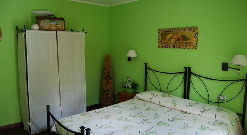 Camera Mela Verde con Tv