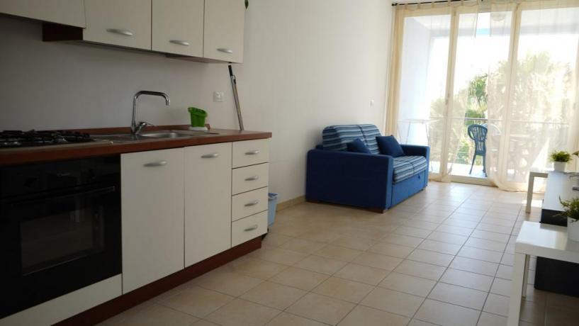 Villaggio con appartamenti cucina e divano letto