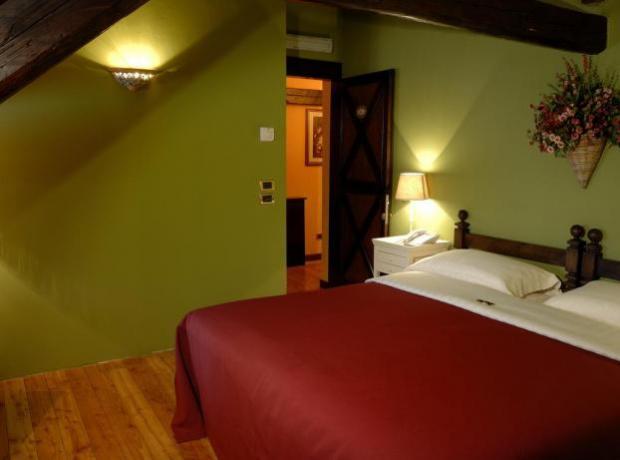 Camera per 2 persone con travi in legno