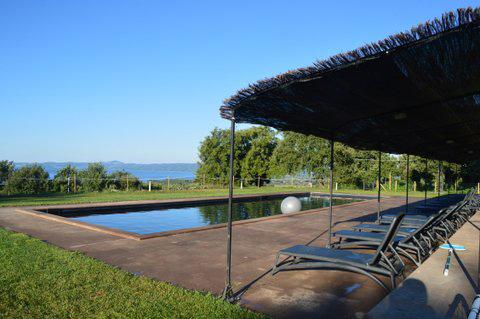 Appartamenti e piscina a pochi passi dal Lago