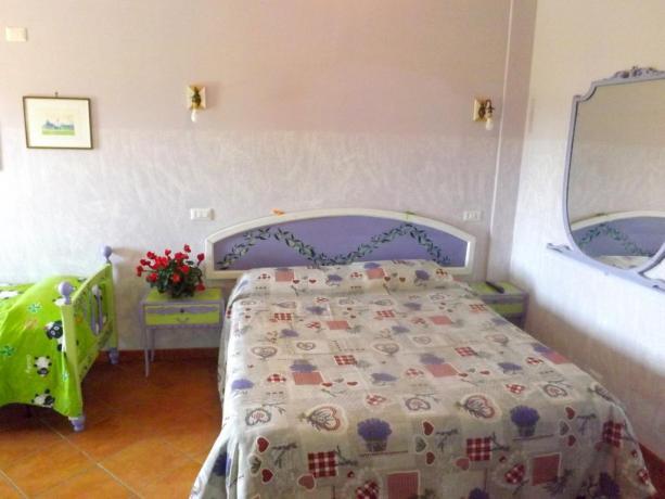 Camera 2+1 con angolo cottura e colazione inclusa