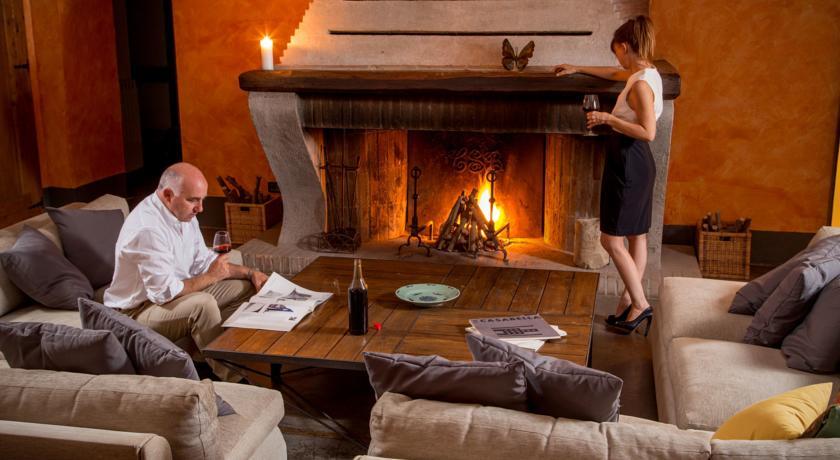 Camera romantica con camino Resort i Cavalli Bracciano