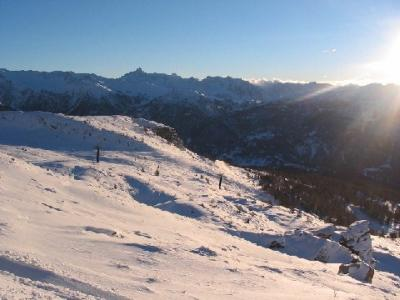 Sunlit skislopes on the hills, San Sicario