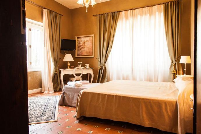Camera matrimoniale elegante e raffinata
