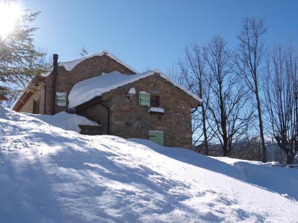 Case vacanze con ampio soggiorno-cucina-tv a Frignano