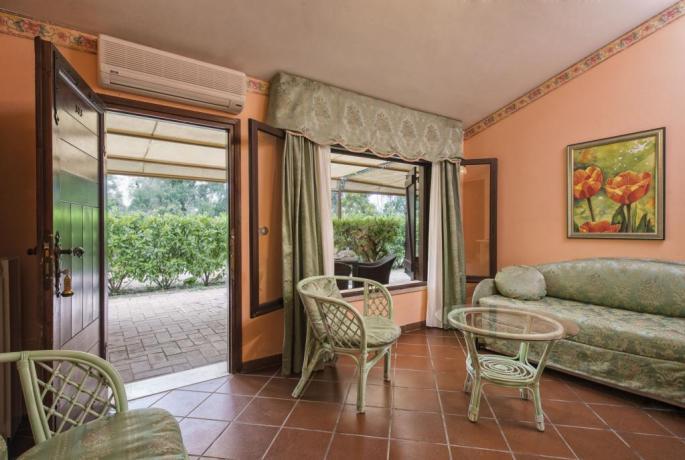 Camere con soggiorno direttamente sul giardino