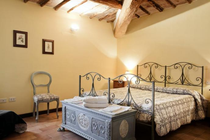 Camera Romantica travi in legno