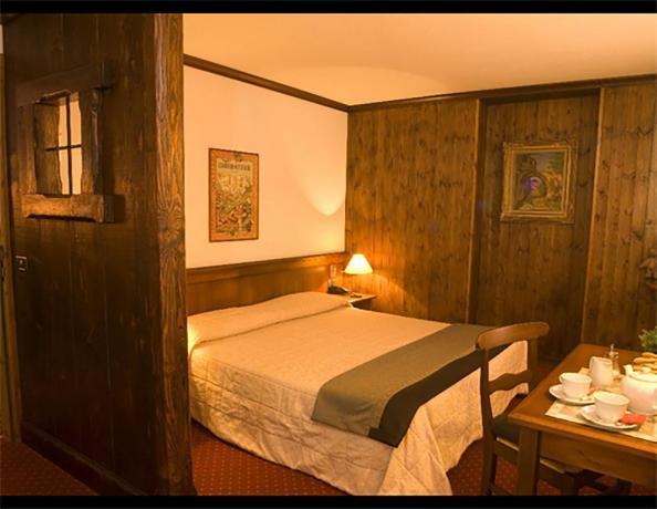 Camera Matrimoniale con mura di legno