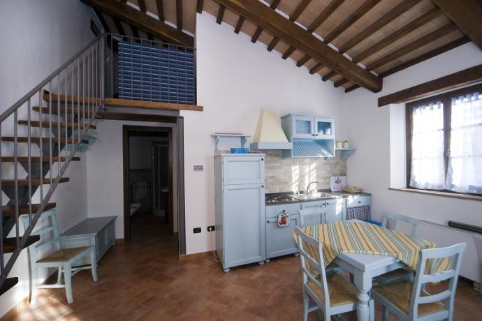 Zona giorno con cucina appartamenti Bolsena