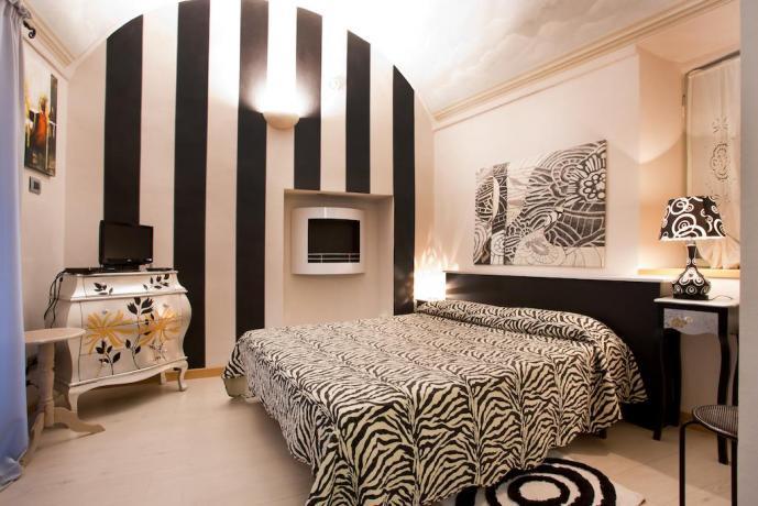 Camera da letto raffinata e moderna