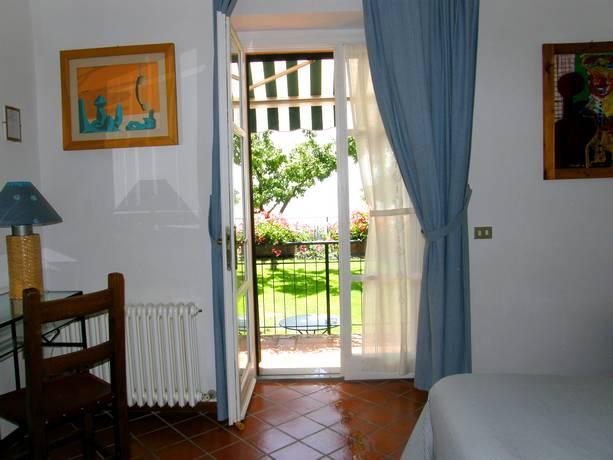 Camera con giardino B&B a Castiglione del Lago