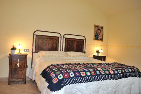 Camera da letto in Casale Vacanza vicino Gubbio