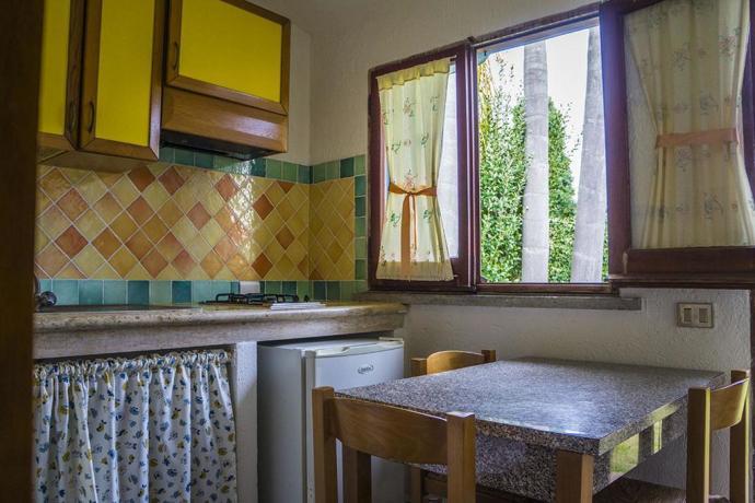 Camere ed Appartamenti zona Sabaudia 'Classic' con cucina.