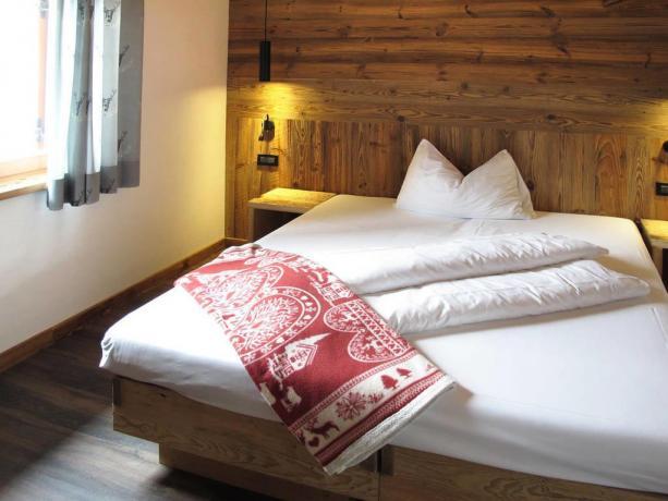 Appartamenti con arredi in legno a S.Vigilio