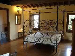 Cottage, letti in ferro battuto