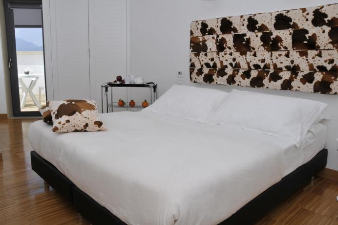 Camere confortevoli per soggiorni romantici a Fondi