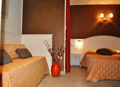 Suite con divano letto e terrazzo