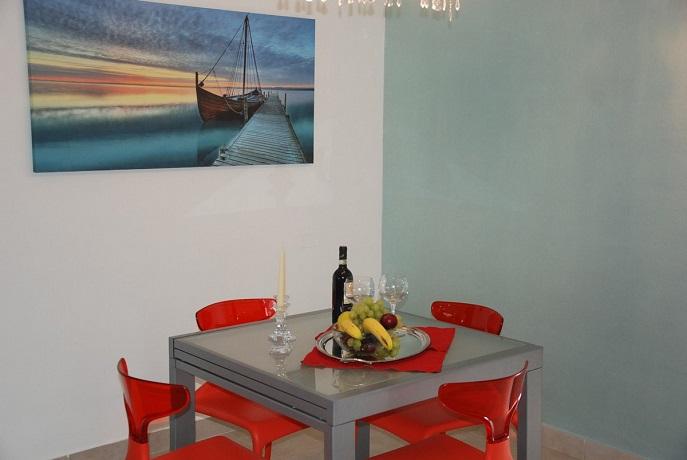 Ampio living con cucina a vista, Suite Family