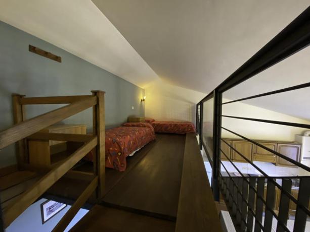 Contadino- Soppalco con letti singoli appartamento 4+2