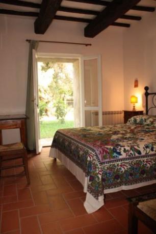 Camera con accesso in giardino, Appartamento Fiordaliso