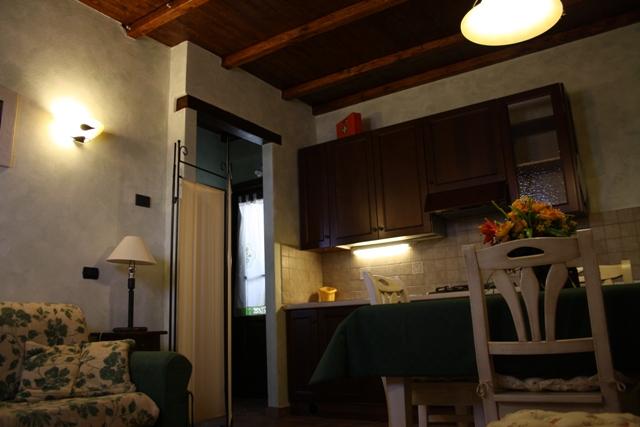 soggiorno e angolo cucina appartamento il Nocio