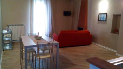 Appartamento Vallis soggiorno con camino
