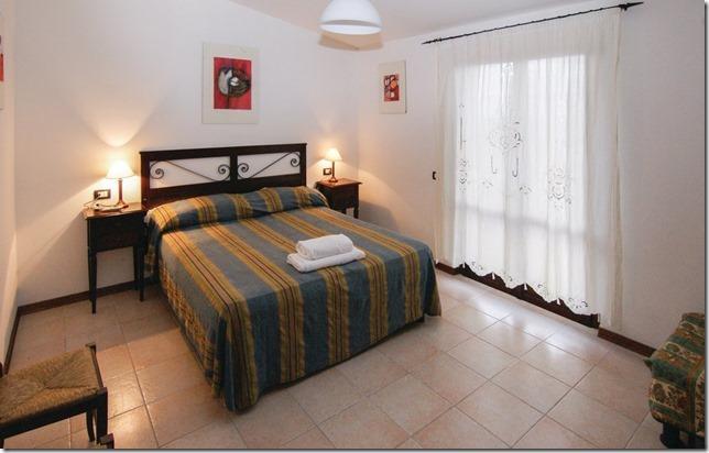 Camera matrimoniale appartamento monolocale casale-agrituristico Magione