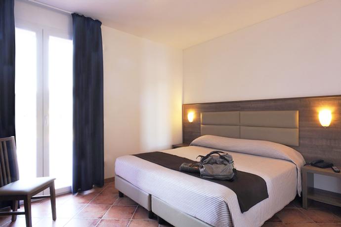 Camera da Letto Bilocale/Trilocale in Residence