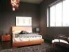 camera moderna con testata in legno