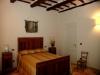 camera da letto con letto in stile
